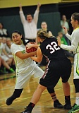 VERN UYETAKE - West Linn guard Caitlin Malvar gets tied up in last week's overtime victory over Tualatin. Malvar filled up the stat sheet as the Lions rallied from an 18-point deficit in the game.