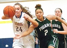 DAN BROOD / TIGARD-TUALATIN TIMES - Newberg senior Sabrina Salmons (left) and Tigard junior Jazmyn Brown battle for the ball in Friday's game.