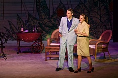 TIMES PHOTO: JAIME VALDEZ - Emile de Becque (Eric Olson) and Nellie Forbush (Maddie Maier) get to know each other a little better in the opening scene of Tualatin High School's production of 'South Pacific.'