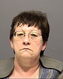 CCSO - Lisa Marie Peterson, 56, shown in a jail booking photo.