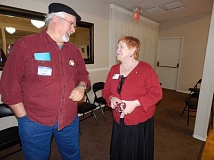 BARBARA SHERMAN - Rep. Margaret Doherty (D-Tigard) chats with Mark Rogers following a March 3 meeting of the East Washington County Democrats in King City.