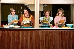 CRAIG MITCHELLDYER/BROADWAY ROSE THEATRE COMPANY - Ready to dish the dirt and the side dishes in the Tigard United Methodist Church kitchen are (from left) Debbie Hunter as Karin, Lori Paschall as Vivian, Kymberli Colbourne as Mavis and Zoe Randol as Signe.