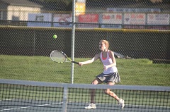 SPOKESMAN PHOTO: COREY BUCHANAN - Wilsonville girls tennis player Samantha Monello volleys at the net against Canby.