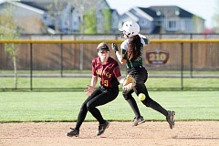HILLSBORO TRIBUNE PHOTOS: AMANDA MILES - West Salem's Bailey Holmquist interferes with Forest Grove's Sierra Gunderson near second base during a Greater Valley Conference softball game, on Friday. Holmquist was ruled out on the play, but her Titans won the game, 4-0.