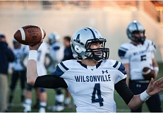 SUBMITTED PHOTO: GREG ARTMAN - Wilsonville junior quarterback Connor Neville chose Washington State University over Boise State University and University of Hawaii.