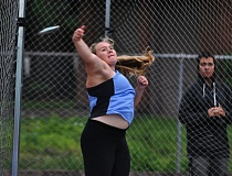 MATTHEW SHERMAN - Maddie Rabing won the shot put and discus at last week's meet in Salem. She enters the year as the defending state champion in both events.