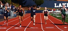 DAN BROOD - Lake Oswego freshman Maddie DeBorde leans across the finish line to score a narrow victory in the 100 meters in last week's meet.