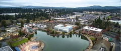 COURTESY OF THE CITY OF TUALATIN - An artist's rendering depicts a possible future three-story Tualatin City Hall, which would include retail and commercial space, alongside the Lake of the Commons in between Southwest Seneca and Nyberg streets.