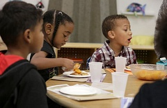 TRIBUNE FILE PHOTO - Preschoolers at Clarendon School have a snack. Schools are where the majority of income taxes go.