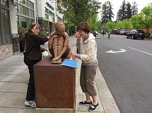 SUBMITTED PHOTO - The Arts Council of Lake Oswego needs volunteers to remove the winter dust from the sculptures in the Gallery Without Walls. All are invited to help clean the sculptures. Arrive at the Arts Council offices, 520 First St. in Lake Oswego by 9:30 a.m. May 7. For more details, call Arts Council Executive Director Nancy Nye at 503-675-3738. To download a walking tour brochure of the Gallery Without Walls visit artscouncillo.org. Here Margie Beckett, left, and Bonnie Cartwright give the sculpture Anillos a good scrubbing.