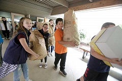TIMES PHOTO: JONATHAN HOUSE - Byrom Elementary students haul donated goods for the Stuff the Bus event.
