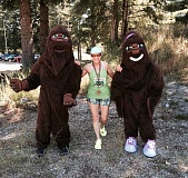 SUBMITTED PHOTO - Jean Shepherd poses with a couple of Sasquatches after completing the Huckleberry Half Marathon in Sandy.