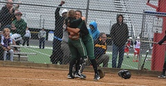 TIMES PHOTO: MATT SINGLEDECKER - Jesuit sophomore pitcher Olivia Strickland and catcher Emily Preble celebrate the Crusaders 1-0 win over Westview on Wednesday.