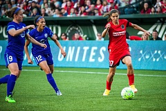 TRIBUNE PHOTO: DIEGO G. DIAZ - Portland Thorns midfielder Tobin Heath takes on two Orlando Pride defenders in the April 17 season opener at Providence Park.