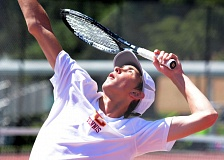 PAMPLIN MEDIA GROUP: DAVID BALL - Joey Schwartz of Central Catholic serves during the Mt. Hood Conference boys singles finals, en route to his league title.