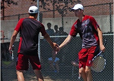 DAN BROOD - Tualatin High School sophomore Kien Nguyen (left) and senior Davis Loen, shown here during Tuesday's quarterfinal round, won the Three Rivers League boys tennis district doubles championship.