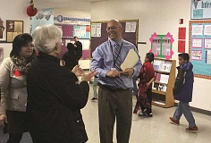 INDEPENDENT FILE PHOTO - Todd Farris, center, leads a tour of Nellie Muir Elementary School in this file photo from 2013. Farris will be leaving Woodburn after many years in the district to head Metzger Elementary in Tigard.