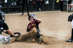 NEWS-TIMES PHOTOS: CHASE ALLGOOD - Forest Grove's  Kinsey Barnett  slides into home during the Vikings 12-11 win over McMinnville.