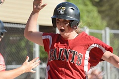 THE OUTLOOK: DAVID BALL - Mt. Hood CCs Rachel Rutledge comes home after hitting a home run during the Saints 6-3 win in Game 2 over SW Oregon on Saturday.