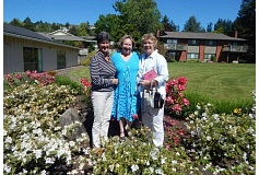 BARBARA SHERMAN - Enjoying the spring sunshine and flowers in front of the King City Clubhouse is this Hello Neighbor planning trio made up of (from left) Nancy Hayes, Peggy Trees and Peg Beckwith.