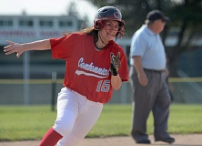 THE OUTLOOK: DAVID BALL - Centennial pinch-runner Lauren Meader rounds third on her way to scoring a go-ahead run for the Eagles in the third inning Tuesday.