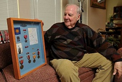 REVIEW, TIDINGS PHOTOS: VERN UYETAKE - A man and his medals. Douglas Barman had an excellent service record in World War II. But until recently he was reluctant to talk about it.