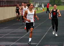 DAN BROOD - Westside Christian junior Jonathan Palau is nearing victory in the 800-meter run Saturday at the West Valley League district meet.