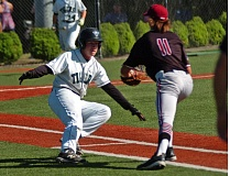 DAN BROOD - Tualatin High School sophomore first baseman Kaden Cook (right) looks to tag out Tigard junior Hunter Hughes on a sacrifice bunt play during last week's Three Rivers League game.