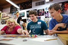 TIMES PHOTO: JAIME VALDEZ - Oregon Connections Academy students Bailie Shinen, Grayson Hoffman and Porter Hoffman play a game of Dixit at Rainy Day Games.
