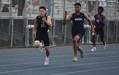 TIMES PHOTO: MATT SINGLEDECKER - Westview senior Samori Toure helped the Wildcats 4x100 relay take first at the Metro League district championship at Aloha High School on Friday with a strong anchor leg that edged Jesuit at the tape.