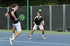 TIMES PHOTO: CLAUDE PELLETIER - Jesuit's Tommy Mulflur (left) and Michael Quinn (right) won Metros doubles championship for the second straight season.