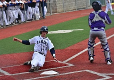 VERN UYETAKE - Lake Oswego's Matt Voelzke slides into home plate to score a run for the Lakers in their playoff victory over Sunset on Monday