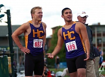 DAN BROOD - Horizon Christian seniors Robbie Cain (left) and Matthew Leong look up at the scoreboard at Hayward Field following the 4 x 100 relay.