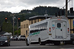 SPOTLIGHT PHOTO: COURTNEY VAUGHN - A CC Rider bus waits at a stoplight in Scappoose during a routine route. The bus agency is slated to get two new buses, one of which will offer easier access to riders in wheelchairs.