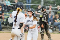 NEWS-TIMES PHOTOS: CHASE ALLGOOD - MaKenna Partain (2) and Katie Ragsdale celebrate after Ragsdale scores during Banks' 12-3 win over South Umpqua Wednesday.