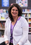 OUTLOOK PHOTOS: JOSH KULLA - Venisha Bahr, recently honored by the Portland Reading Council, works with educators in the library at Dexter McCarty Middle School.