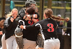 SANDY POST: DAVID BALL - Mt. Hood CC catcher Darian Lindsey jumps into the arms of pitcher Kayla Byers after a strikeout ended Mondays 7-2 championship game victory.