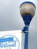 SPOKESMAN PHOTO: JAKE BARTMAN - Ornamental streetlights, including the acorn design used on Wilsonville Road near Old Town, are among those that will be replaced later in the City's streetlight conversion project.