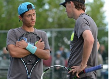 THE OUTLOOK: DAVID BALL - Greshams Florin Miron, left, and Blain Mott take a moment to discus strategy during a first-set switchover Thursday night.