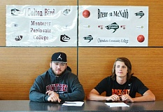 SPOTLIGHT PHOTO: JAKE MCNEAL - Indians senior Colton Bird (left) signed his collegiate letter of intent to study at and play football for Monterey Peninsula College (Calif.), as did senior Brennen McNabb (right) with Chemeketa Community College (Salem) basketball.