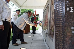 TIMES PHOTO: JAIME VALDEZ - Don Janigian places a wreath at the Vietnam Memorial during its rededication at Beaverton Veterans Memorial Park. The memorial bears the name of his brother, Cpl. Richard A. Janigian, a Marine who died while serving in the Vietnam War in 1967.