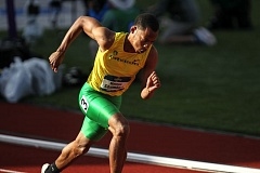 TRIBUNE PHOTO: DAVID BLAIR - Marcus Chambers of the Oregon Ducks takes off in the NCAA 400 meters on Friday at Hayward Field.
