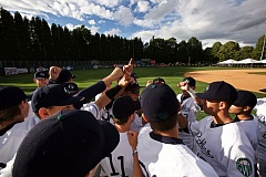 TRIBUNE PHOTO: JAIME VALDEZ - The Portland Pickles huddle before taking the field for the first time at Walker Stadium.