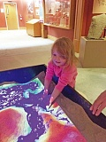 SUBMITTED PHOTO - Clementine Blaylock, 3, tries out the hands-on approach to the sandbox, one of three new exhibits aimed at children at the Museum of the Oregon Territory.