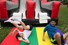 TIMES PHOTO: JAIME VALDEZ - Sam Smith, 15, left, and Sam Katsuda, 14, slide to the bottom of an inflatable during the eighth-grade party at Hazelbrook Middle School.