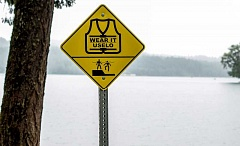 NEWS-TIMES FILE PHOTO - This sign at Hagg Lake south of Forest Grove could be clearer in its warning about steep drop-offs near the Sain Creek Picnic Area.