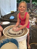 SUBMITTED PHOTOS:  - High school ceramics students will help younger children on the potters wheel at the festival.