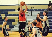 SPOTLIGHT PHOTO: JAKE MCNEAL - Indians sophomore guard Jerad Toman lifts for a layup in Scappoose's 46-27 loss to Banks on Tuesday, June 7, at Banks High School. The Indians beat Yamhill-Carlton 51-29 in the earlier game for their first win of the summer.