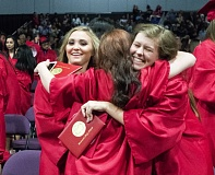 OUTLOOK PHOTO: JOSH KULLA - Centennial graduates hug at the conclusion of the school's 2016 graduation ceremony at the Portland Expo Center.