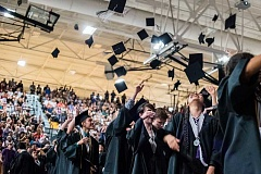 HILLSBORO TRIBUNE PHOTO: CHASE ALLGOOD - Century High School's class of 2016 thrown their hats in the air.